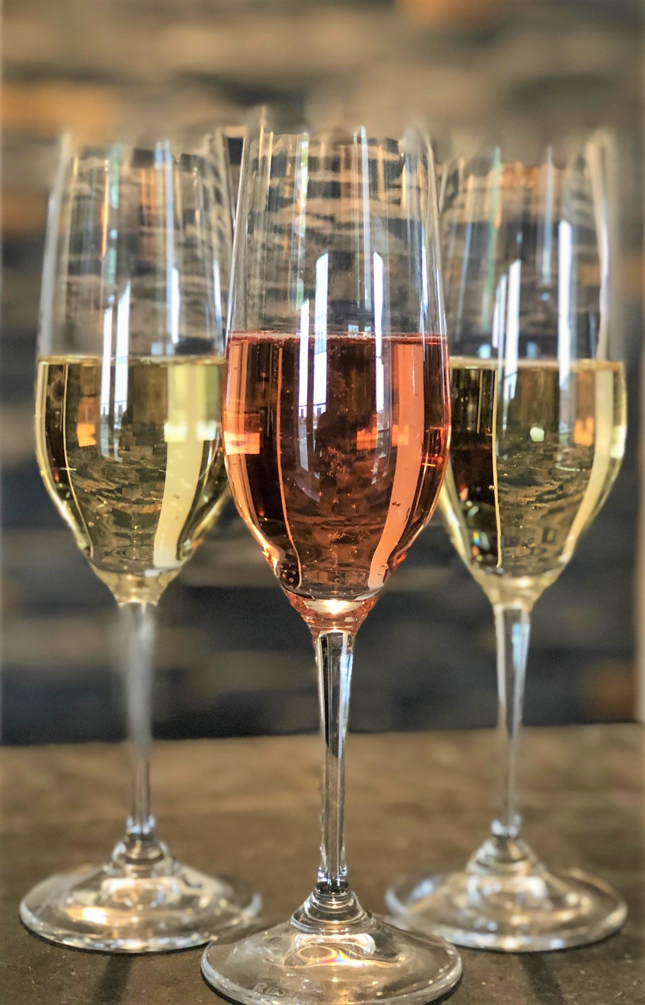 Three sparkling wine glasses